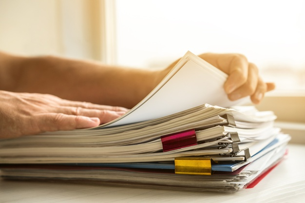side-view-man-arranging-business-files_23-2148377708
