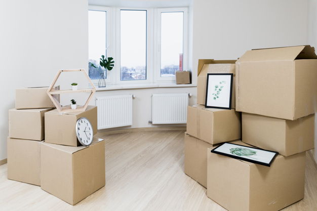stack-moving-cardboard-boxes-new-apartment_23-2148060032
